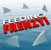 stock photo of fin  - Feeding Frenzy in 3d letters on water surface with shark fins surrounding them to illustrate fierce and deadly competition in a game - JPG