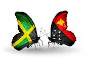 foto of papua new guinea  - Two butterflies with flags on wings as symbol of relations Jamaica and Papua New Guinea - JPG