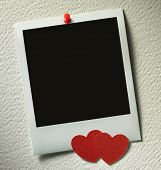 stock photo of polaroid  - polaroid style photo frames on paper background with paper heart - JPG