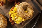 foto of bagel  - Hearty Breakfast Sandwich on a Bagel with Egg Bacon and Cheese - JPG