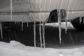 picture of exhaust pipes  - rear of car with icicles in front of exhaust pipe - JPG