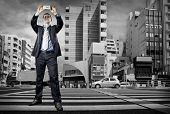 picture of crossroads  - Businessman speaking by phone on the crossroad - JPG