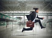 picture of running-late  - Businessman runs in the airport because late - JPG