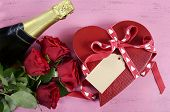 pic of shabby chic  - Happy Valentines Day red heart shape gift box with bottle of champagne and red roses on shabby chic vintage style pink wood table background - JPG