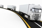 picture of trucking  - White Trucks on freeway - JPG