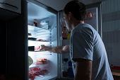 picture of refrigerator  - Portrait Of A Man Taking Food From Refrigerator - JPG