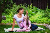 picture of eat grass  - Mother and daughter eat ice - JPG