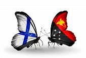 picture of papua new guinea  - Two butterflies with flags on wings as symbol of relations Finland and Papua New Guinea - JPG