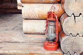image of kerosene lamp  - Kerosene lamp on wooden hose background - JPG