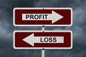 pic of profit  - Profit versus Loss Red and white street signs with words Profit and Loss with stormy sky background - JPG
