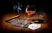 picture of cigar  - Playing cards near wineglass of whiskey and cigar - JPG