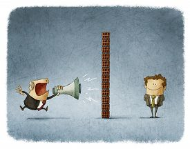 foto of shout  - boss shouting with a megaphone to an employee who is behind a brick wall and does not get any sound - JPG