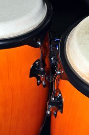 picture of congas  - A pair of orange congas isolated on a black background - JPG