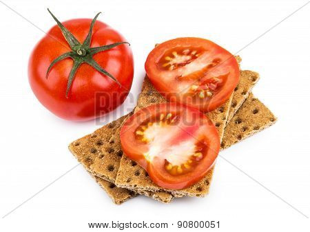 Wheat Crisp Bread And Tomato Isolated On White