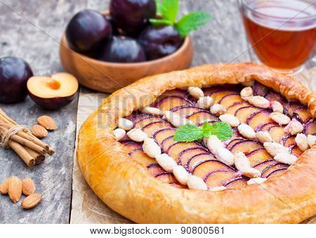 Homemade Plum Pie With Almonds On The Table
