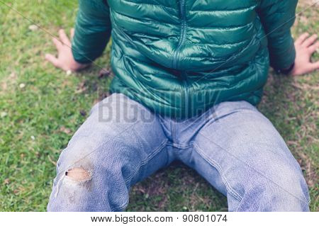 Man With Torn Jeans On Grass
