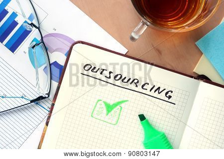 Notepad with word outsourcing concept