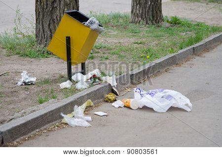 Debris Is Scattered Around The Garbage Bins
