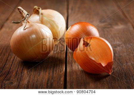 Still Life With Onions On An Old Table