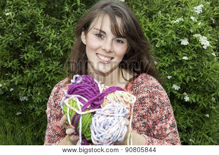 Young Woman With Bale Of Wool