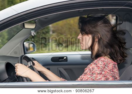 Young Woman Driving In A Car