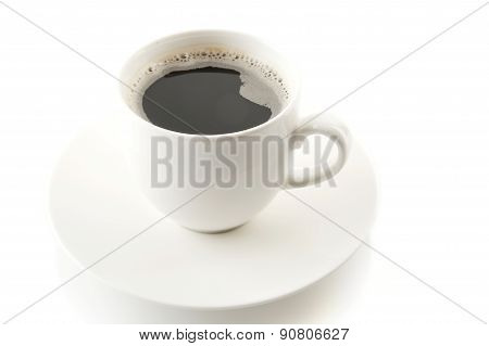 Cup Of Coffee With Saucer On White