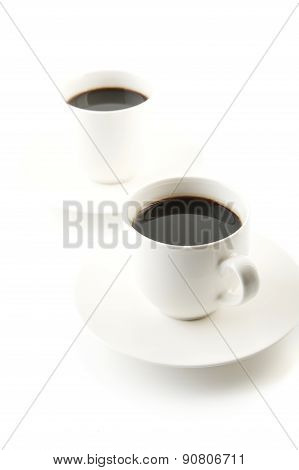 Cups Of Coffee With Saucer On White