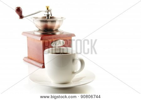 Cup Of Coffee With Saucer And Mill On White
