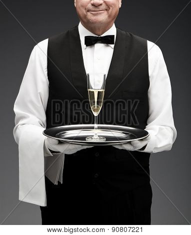 butler and champagne flute