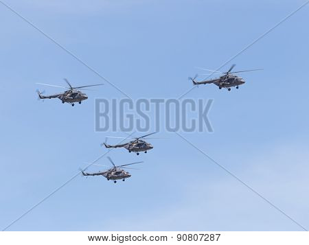 Mi-8 Helicopters Flying Formation On The Blue Sky