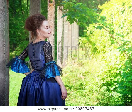Beautiful Young  Woman In Blue Medieval Dress Outdoor