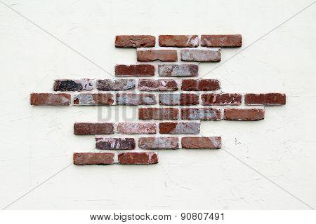 Stucco and brick wall.