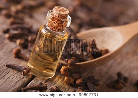Clove Oil In A Bottle Close-up On The Table, Rustic