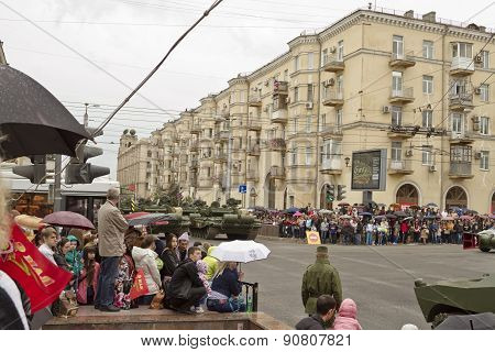 The Inhabitants Of The City In The Rain Awaiting The Start Of The Procession Of Military Vehicles At
