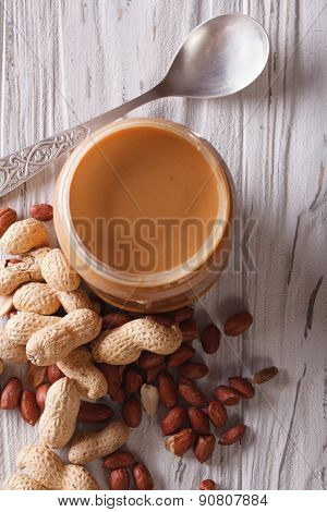 Peanut Butter In A Glass Jar And Nuts Vertical Top View