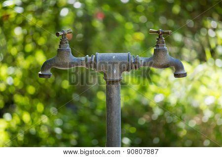 Two symmetrical taps