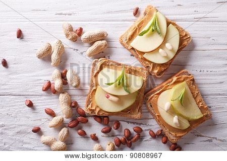 Sandwiches With Peanut Butter And An Apple Horizontal Top View