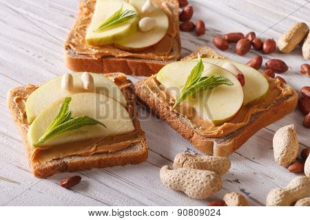 Toast With Fresh Apple And Peanut Butter Closeup. Horizontal