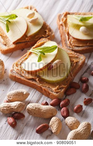 Toast With Fresh Apple And Peanut Butter On The Table. Vertical