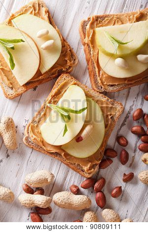 Sweet Toast With Apple And Peanut Butter Vertical Top View
