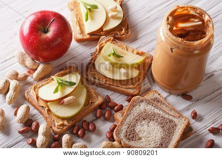 Sandwiches With An Apple And Peanut Butter Horizontal Top View