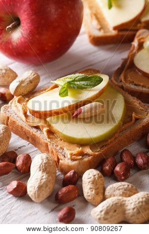Sweet Sandwich With Peanut Butter And Apple Close Up