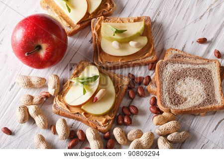 Sandwiches With Peanut Butter And An Apple. Horizontal Top View