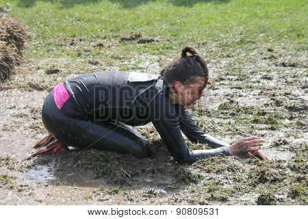 Woman Standing On Her Knees Through The Mud