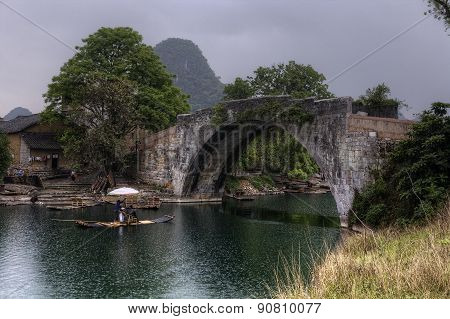 Cruising On  Bamboo Boat In Yulong River, Guilin, Guangxi, China.