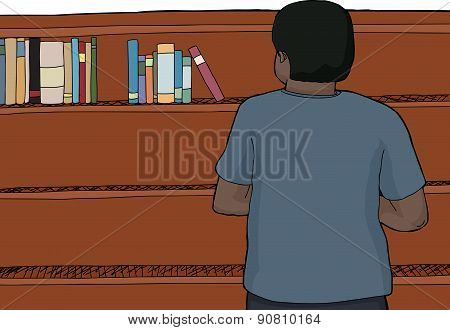 Man Looking At Top Of Shelf