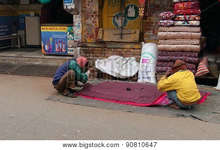 Indian Men Sew Blanket Near Market On The Street