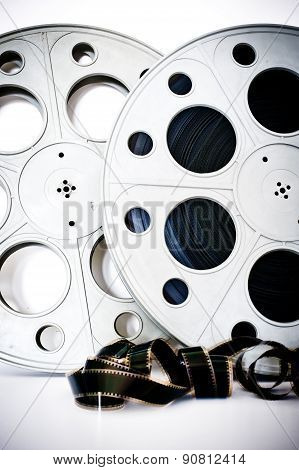 35 Mm Movie Cinema Reels With Film Unrolled On White