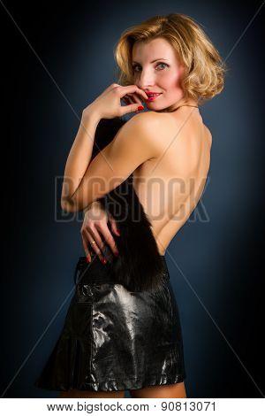 Blonde Girl On Dark Background