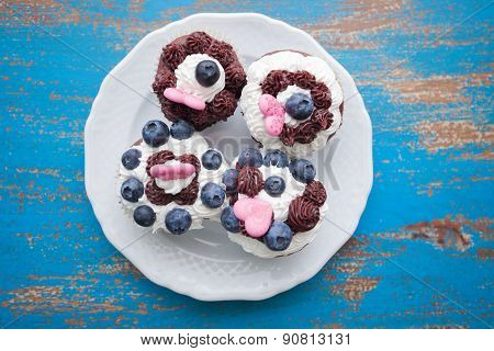 Decorated Cupcakes On White Plate